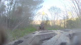 ATV through Mud on a Trail