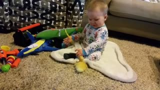 Baby boy's first meeting with baby chick will melt your heart
