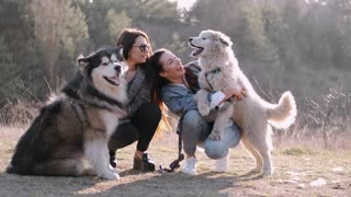 Women Holding Their Dogs / Cute Animals