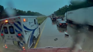 Ambulance Driver Clips Truck Mirror during Response