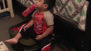 Funny 2 years old boy sleeping.
