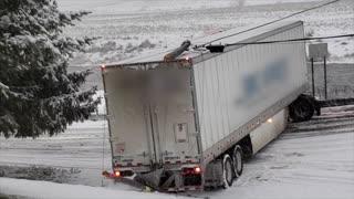 Truck Stuck Across Road