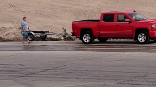 Dad Gets Impatient While Teaching Daughter to Back Trailer Down Boat Ramp