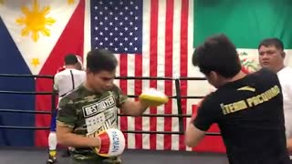 MANNY PACQUIAO TRAINS SON