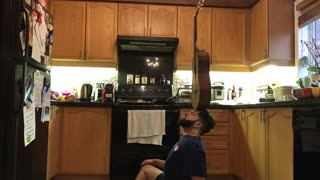 Guy Skillfully Balances Various Objects on His Head