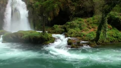 Waterfalls with a flowing river