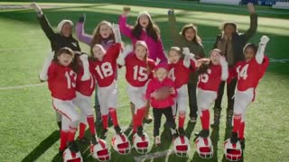 Girls playing football/Budweiser brewing with wind power