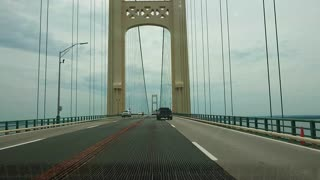 Crossing the Mackinac bridge by a car.