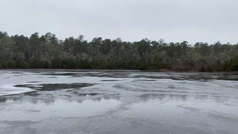 Windy winter pond.