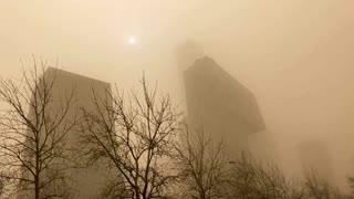 Beijing chokes in dust storm