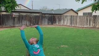 Kiddos Excited over Backyard Rainbow