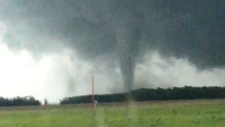 Vehicle speeds away from incoming tornado in Indiana