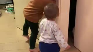 Jayden playing peekaboo with ball