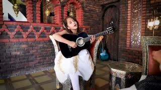 Cute girl singing despacito guitar