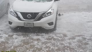 Hail Storm Beats and Batters a Car