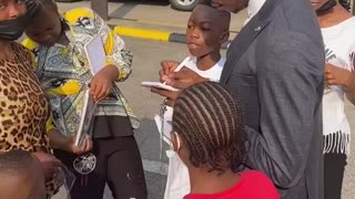 Singer, Moses Bliss Celebrates Children's Day with Children on the street of Lagos