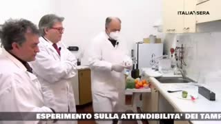 ITALY Scientists use lateral flow antigen rapid SARSCoV2 test on a kiwi fruit which is positive