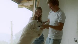 A happy Family playing with thier White dog🤣