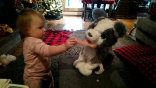 BABY GRANDAUGHTER VIOLET FEEDING HER PUPPY