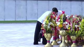 North Koreans mark anniversary of former leaders