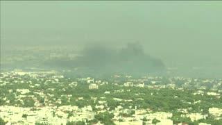 Athens wakes as wildfires burn through the night
