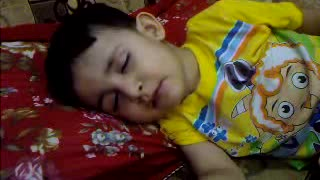 Funny Kid eats while sleeping