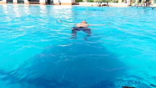 Swimmer Knows How To Hold Breath In Pool Floating Skills