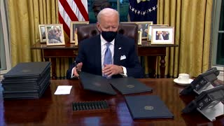 Barely on the job, Biden signs executive actions