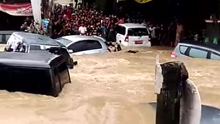 Cars Washed Away in Surprise Flooding