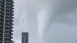 Waterspout-turned-tornado sweeps coast as thunderstorms pound South Florida