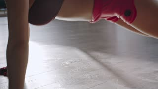 the sexy woman doing push up exercise on the floor