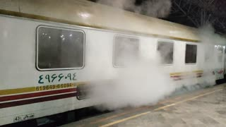 Steam coming out of a train in Tehran Railway Station