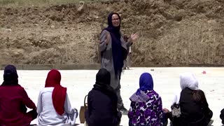 Afghan girl vows to keep learning after school attack