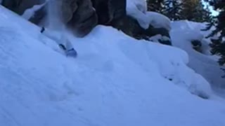 Guy blue jacket skiing fall off cliff