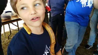 Little boy with snake
