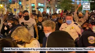 Rand Paul surrounded by protesters on Thursday night