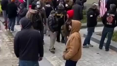 American yelling for police help at Capital