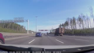 Runaway Tire Nearly Misses Car