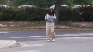 Crazy lady dances in the middle of the street