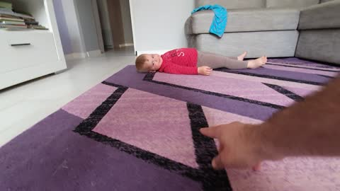 This baby adorably runs from dad's hand-spider