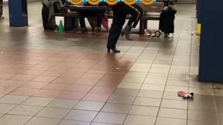 """Man dances to """"she's a bad mama jama' in heels in a subway station"""