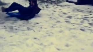 Guy on blue sled crashes into house