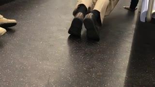 Man does push ups on the floor of subway train