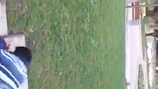 Kid glasses blue striped shirt cartwheel falls on cement floor