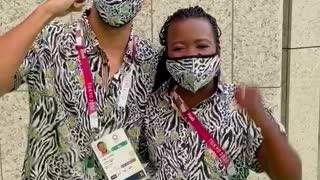 Phumelela Mbande and Chad le Clos Team SA Flag Bearers