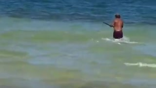 Local Hunters Catching Fish With a Spear