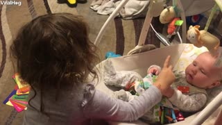 Big Sister Teaches Baby Brother How to Sign