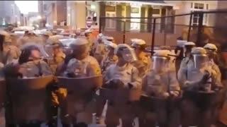 Military veteran protestor yells at the National Guard