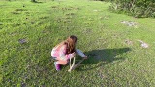 Little girl catches huge coachwhip snake