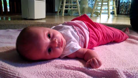 6-week-old baby rolls over for first time